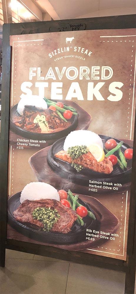 sizzlin' steakの入口にある看板